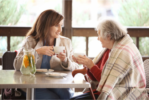 caregiver and the old woman talking to each other