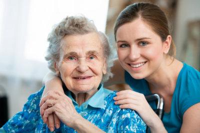 portrait of caregiver and senior woman